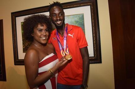 EREEM AND HIS LADY: File photo from August 16 2017 shows national sprinter Jereem Richards displaying his IAAF World Championship medals with his girlfriend Kayja Thomson, at the VIP Lounge, Piarco International Airport.   —Photo: CURTIS CHASE