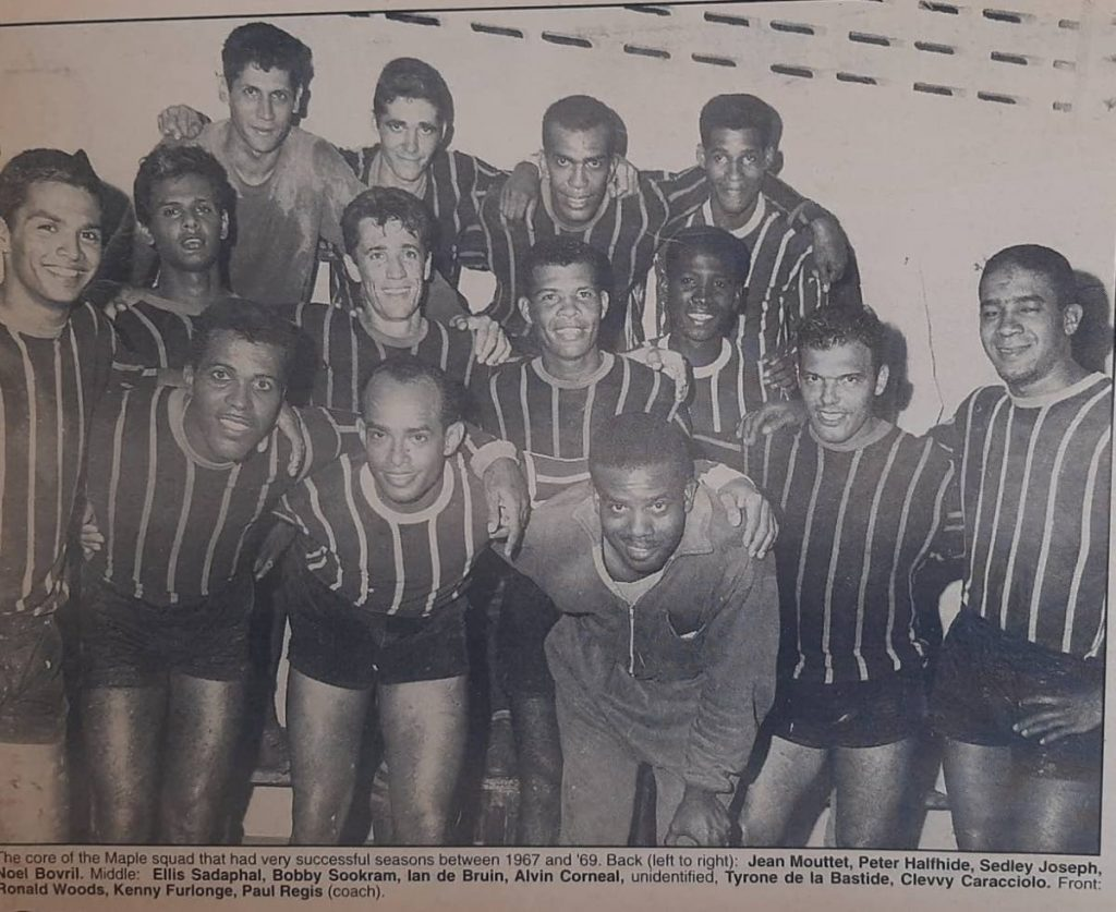The core of the Maple squad that had very successful seasons between 1967 and '69. Back (left to right): Jean Mouttet, Peter Halfhide, Sedley Joseph, Noel Bovril. Middle: Ellis Sadaphal, Bobby Sookram, Ian de Bruin, Alvin Corneal, unidentified, Tyrone de la Bastide, Clevvy Caracciolo. Front: Ronald Woods, Kenny Furlonge, Paul Regis (coach). - Photo via Shaun Fuentes